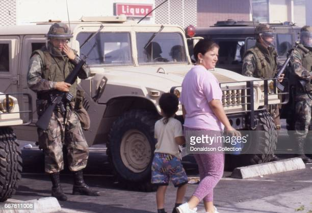 National Guard troops defend a Ralph's Grocery story from looting at Viva Bargain Center at 172 S. Vermont Ave. That erupted after the acquittal of 4...