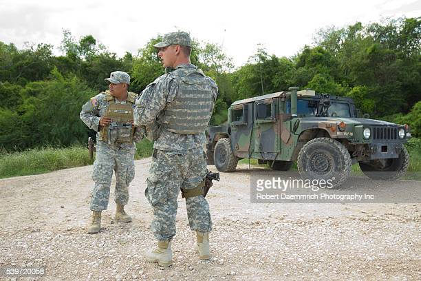 National Guard troops do a shift change on the Rio Grande levee near Anzalduas Park in Granjeno TX south of Mission in Hidalgo County Texas Governor...