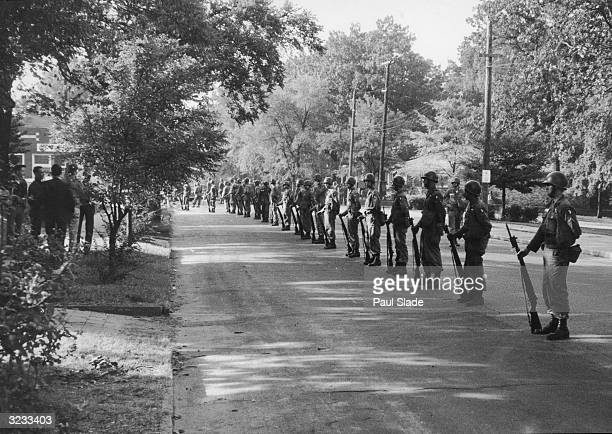 National Guard troops form a line in a street to enforce the nation's first desegregation at Central High School in Little Rock Arkansas