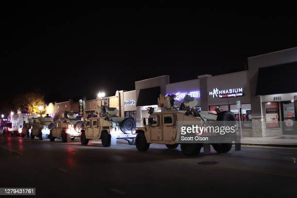 National Guard troops help police clear protestors following a brief skirmish near the Wauwatosa City Hal on October 09, 2020 in Wauwatosa,...