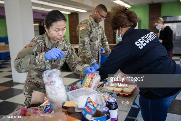 S National Guard troops help put together meals for distribution to local residents at the WestCop community center on March 18 2020 in New Rochelle...