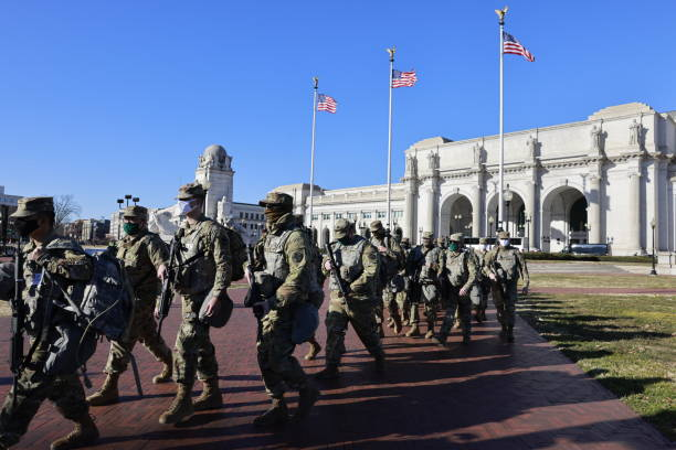 National Guard troops march from Union Station on the eve of the inauguration of president elect Joe Biden