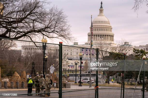 National Guard troops patrol a fenced permitter around the U.S. Capitol on January 19, 2021 in Washington, DC. Tens of thousands of National Guard...