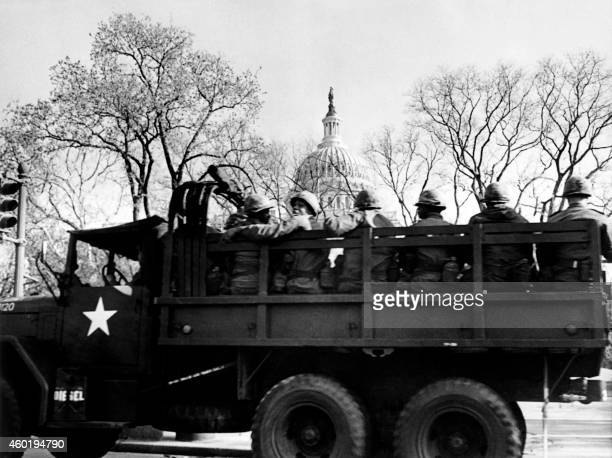 National guard troops patrol outside the Capitol in Washington DC on April 05 1968 after US President Lyndon B Johnson called out troops to keep...