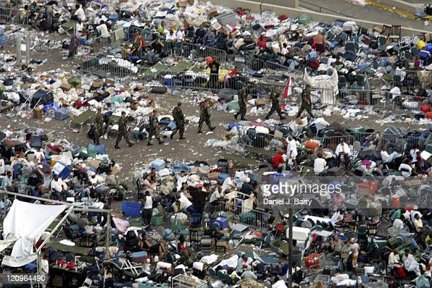National Guard troops patrol through the crowd at the Superdome in New Orleans on Saturday September 3 2005 The city remains under water as military...
