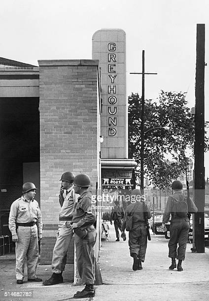 National Guard troops, sent in by United States Attorney General Robert Kennedy after rioting broke out on May 21 patrol near the Greyhound Bus...