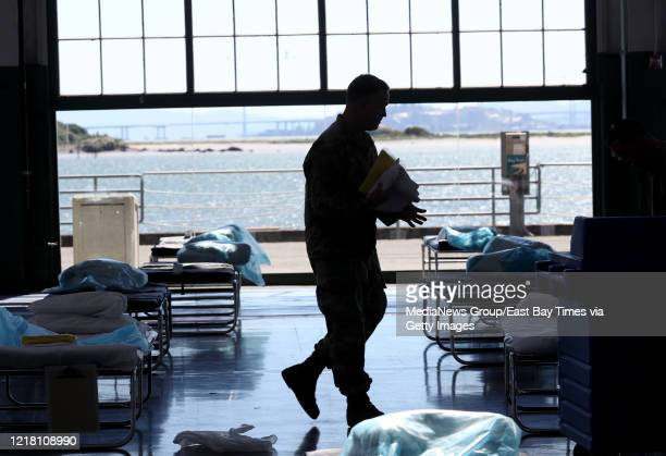 National Guard troops set up beds at the Craneway Pavilion in Richmond Cailf on Thursday April 2 2020 The 45000square foot pavilion is being...