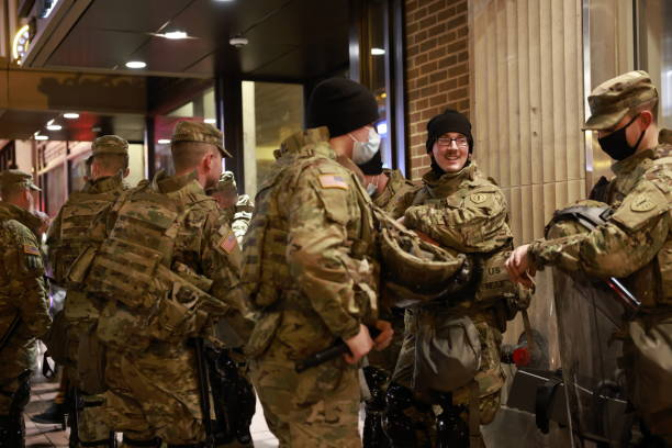 National Guard troops stand outside a hotel before the inauguration of Joe Biden