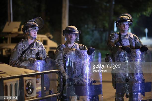 National Guard troops stand watch near a group of demonstrators near the Wauwatosa City Hal on October 09, 2020 in Wauwatosa, Wisconsin. The city has...