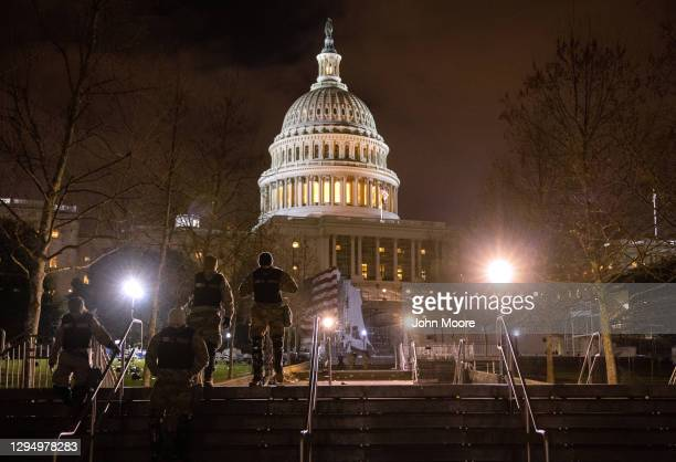 National Guard troops walk through the grounds of the U.S. Capitol on January 06, 2021 in Washington, DC. A pro-Trump mob stormed the Capitol...