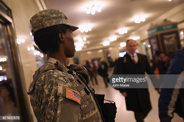 National Guard troops watch as commuters arrive to Grand Central Station on November 7 2016 in New York City The city is on a hightened state of...