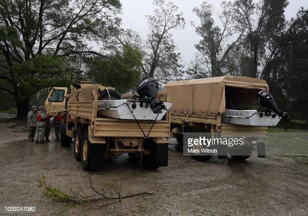 National Guard trucks with FEMA boats are parked after Hurricane Florence hit the area on September 14 2018 in Wilmington North Carolina Hurricane...