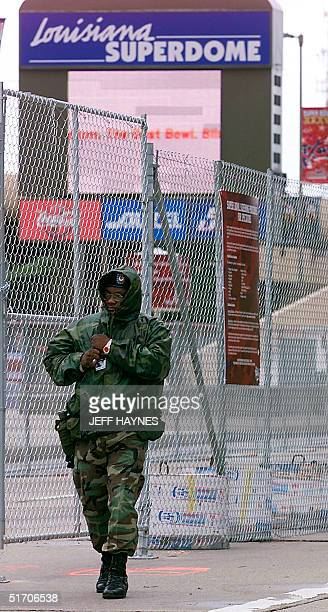 National Guard units from around the US patrol outside the Superdome with two eightfoot chainlink fences securing the perimeter of the dome 01...