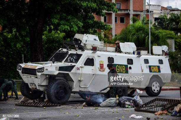 A National Guard vehicle goes through a barricade built by antigovernment activists in Venezuela's third city Valencia on August 6 a day after a new...