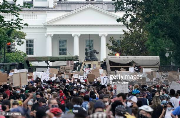 C National Guard vehicles are used to block 16th Street near Lafayette Park and the White House as Demonstrators participate in a peaceful protest...