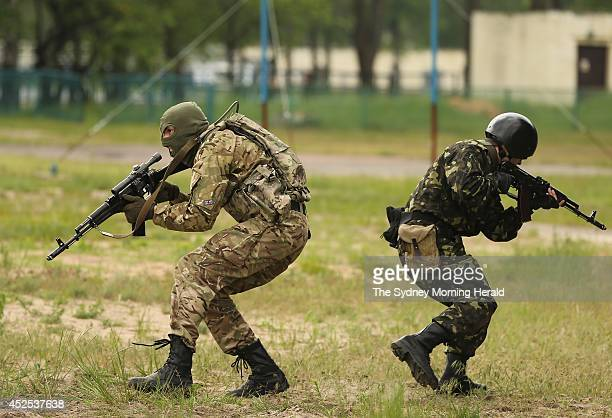 National Guard volunteers train at the National Guard military base near the village of Novi Petrivtsi on the outskirts of Kiev Ukraine May 20 2014