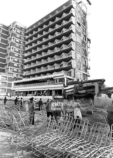National Guards men and civilians walk through the fore court of the Famagusta's Salaminia Tower Hotel sliced like a cake one section of the tenstory...