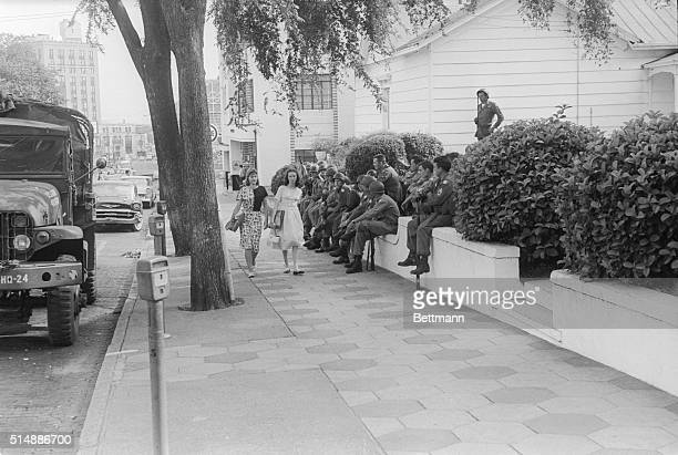 National Guardsmen are posted across the street from the bus station as Martial law is imposed in this former capital of the Confederacy in the wake...