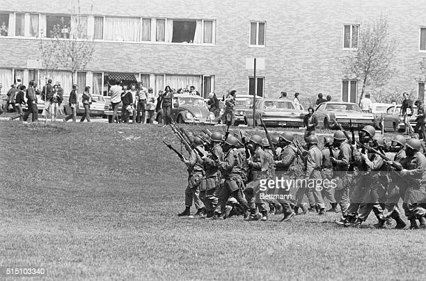 National Guardsmen are seen here on May 4th moving across the common on the Kent State campus, where four anti-war protesters were shot and killed...