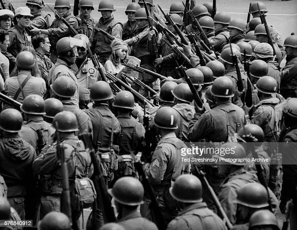 National guardsmen, called out by Governor Reagan to quell demonstrations, surround a Vietnam War protester during the People's Park Riot in...