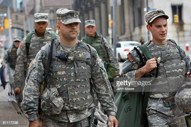 National Guardsmen carry riot gear near the site of the G20 Summit on September 24 2009 in downtown Pittsburgh Pennsylvania Military forces from...