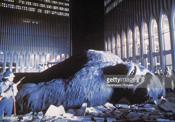National Guardsmen stand around the wounded giant gorilla as he lies in a pile of rubble between the Twin Towers of the World Trade Center in a still...
