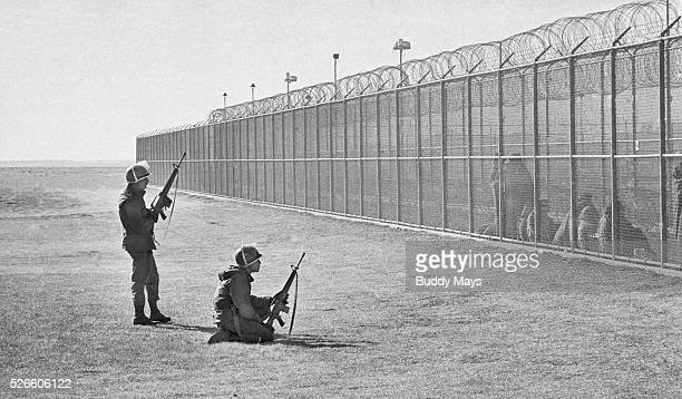 National Guardsmen stand guard over blanketwrapped inmates in the New Mexico State Prison near Santa Fe in 1980 Earlier prisoners rioted in the...