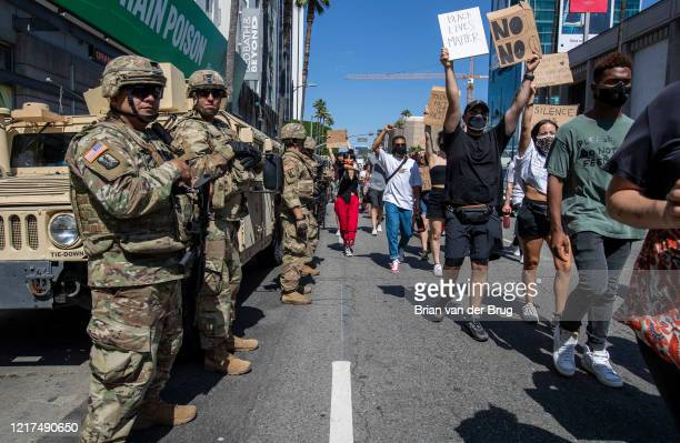 National Guardsmen watch as protesters march through Hollywood to demand justice for the killing of George Floyd during march on Wednesday, June 3,...