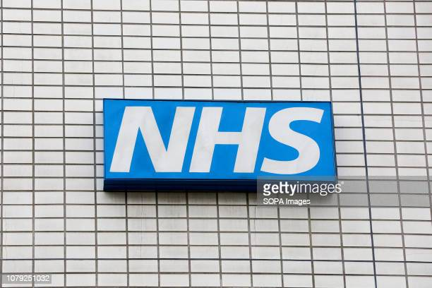 National Health Service logo is seen outside a hospital in Westminster