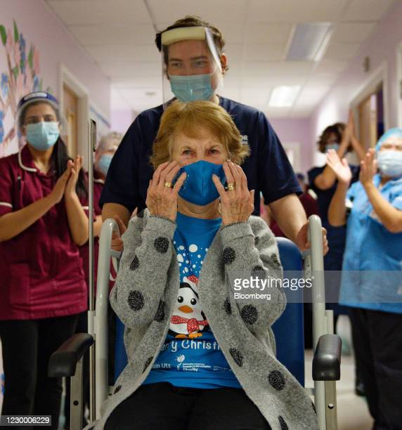 National Health Service staff applaud Margaret Keenan as she is returned to her ward after becoming the first person in the U.K. To receive the...