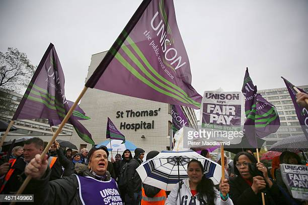 National Health Service workers gather outside St Thomas' Hospital on October 13 2014 in London England NHS workers are holding a four hour strike...