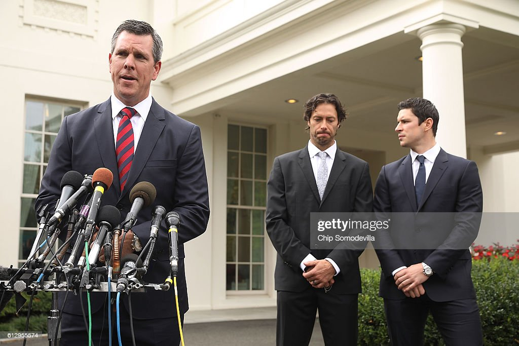 National Hockey League champion Pittsburgh Penguins Coach Mike Sullivan (L) talks to reporters with players Matt Cullen (C) and Sidney Crosby after celebrating their Stanley Cup victory in the East Room of the White House October 6, 2016 in Washington, DC. The Penguins defeated the San Jose Sharks in six games in the 2016 NHL Finals, the fourth time the franchise has won the Stanley Cup.