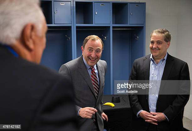 National Hockey League Commissioner Gary Bettman jokes around with Phil Esposito and owner of the Tampa Bay Lightning Jeff Vinik before Game Two...