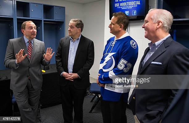 National Hockey League Commissioner Gary Bettman tells a story to Tampa Bay Lightning Owner Jeff Vinik St Petersburg Florida Mayor Rick Kriseman and...