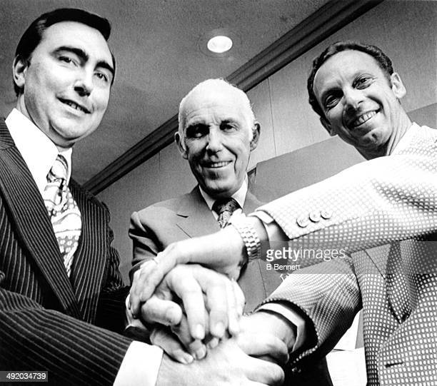 National Hockey League President Clarence S Campbell shakes hands with Edwin G Thompson and Abe Pollin after Thompson was awarded the Kansas City...