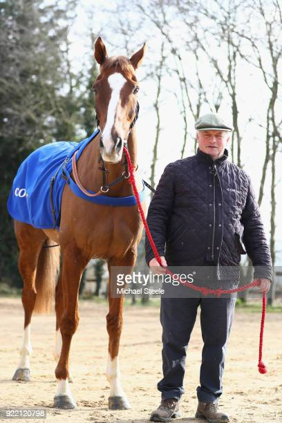 National hunt trainer Colin Tizzard poses with Native River during a media stable visit at Spurles Farm on February 21 2018 in Sherborne England