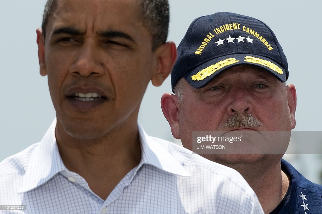National Incident Coordinator Admiral Thad Allen (R) listens as US President Barack Obama makes a statement on the federal government's response to the Gulf Coast oil spill at the US Coast Guard Station Grand Isle, Louisiana, on May 28, 2010. Obama stepped up the battle against a massive slick lapping the stricken Gulf Coast, vowing never to abandon those caught in the worst US oil spill. Tripling the manpower already feverishly working to protect the southern US coastline, he pledged 'to continue to do whatever it takes to help Americans whose livelihoods have been upended by the spill.' AFP PHOTO/Jim WATSON