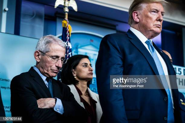 National Institute for Allergy and Infectious Diseases Director Dr. Anthony Fauci listens as President Donald J. Trump announces that the outbreak...