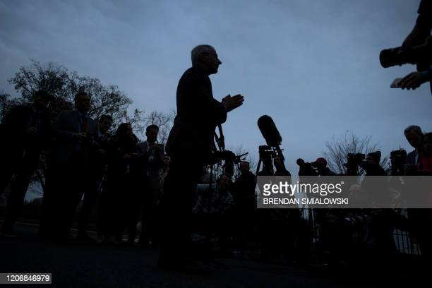 National Institute of Allergy and Infectious Diseases Director Dr Anthony Fauci listens to a question while speaking to the press outside the White...