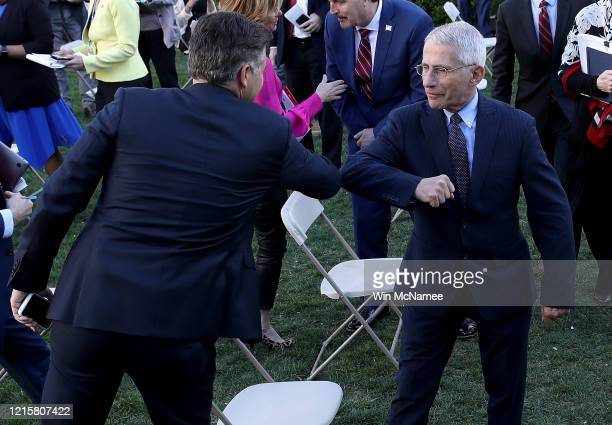 National Institute of Allergy and Infectious Diseases Director Anthony Fauci bumps elbows with CNN correspondent Jim Acosta following the daily...