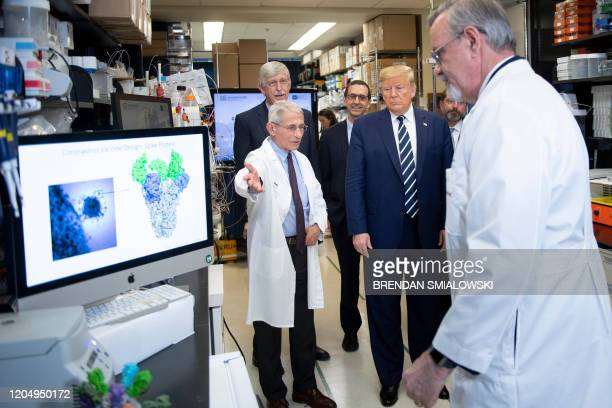 National Institute of Allergy and Infectious Diseases Director Tony Fauci speaks to US President Donald Trump during a tour of the National...