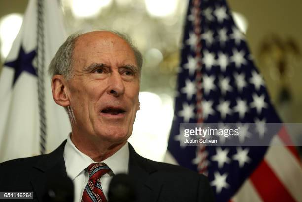 National Intelligence Director Dan Coats speaks to reporters after a swearingin ceremony at the US Capitol on March 16 2017 in Washington DC The US...