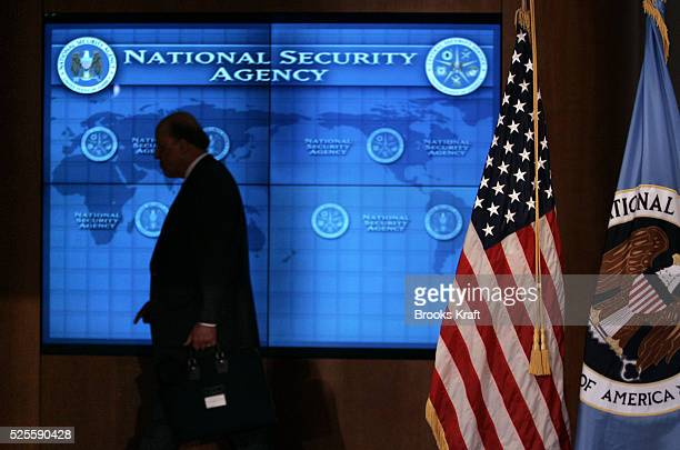 US National Intelligence Director John Negroponte walks past a video screen during a visit by US President George W Bush at the National Security...