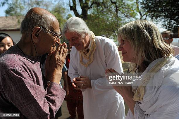 US national JesseBlue Forrest and Canadian SandraMoon Dancer do a traditional Namaste greeting to the noted Gandhian and Gujarat Vidyapith Chancellor...