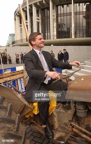 National leader Bill English rides a tractor at Parliament Thursday as farmers protest against the fart tax which will be levied as part of the Kyoto...