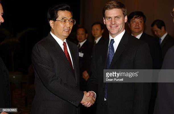 National Leader Bill English shakes hands with President Hu Jintao of the People's Republic of China during a brief meeting at the Sheraton Hotel...
