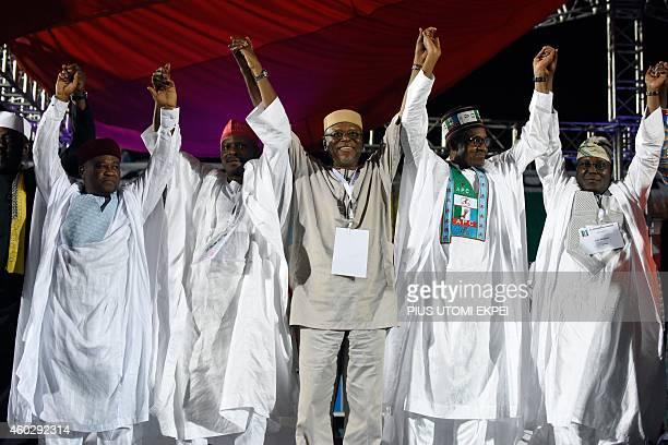 National leader of the opposition All Progressives Congress John OdigieOyegun raises his hands of presidential aspirants of the party Rochas Okorocha...