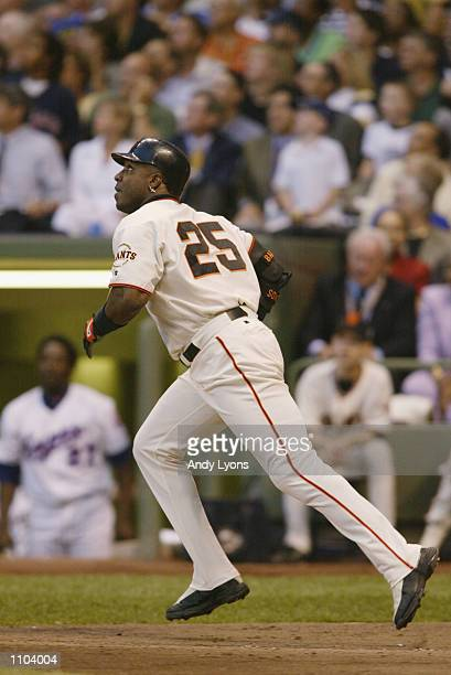 National League All Star left fielder Barry Bonds watches the flight of his firstinning flyout to deep center field during the MLB All Star Game July...