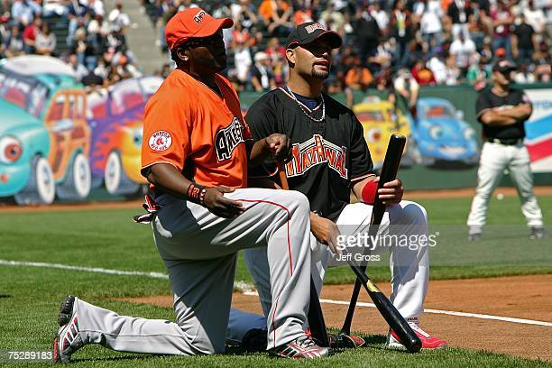 National League AllStar Albert Pujols of the St Louis Cardinals and American League AllStars David Ortiz of the Boston Red Sox talk on the field...