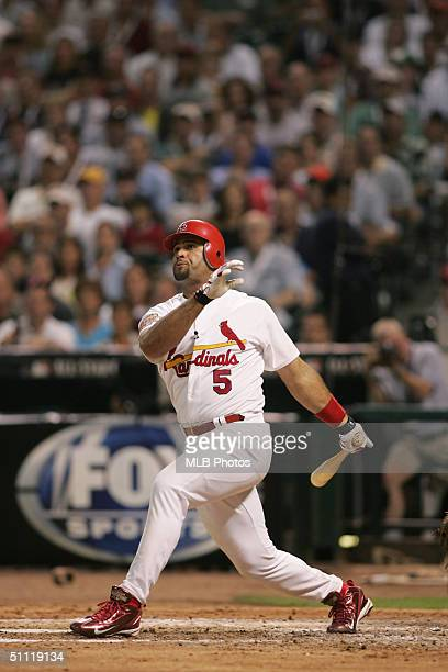 National League All-Star Albert Pujols of the St. Louis Cardinals doubles in the fourth inning during the Major League Baseball All-Star Game at...